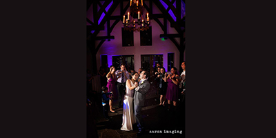 Purple and blue uplighting provided by A Bride's DJ Cleveland